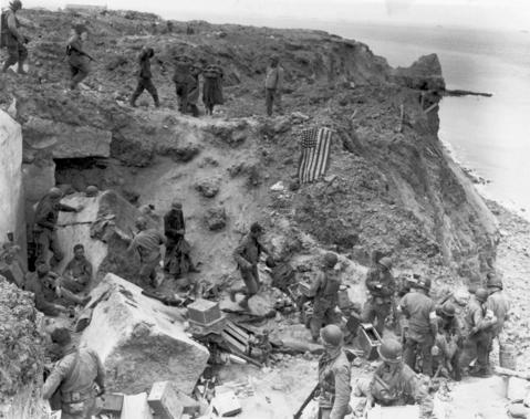 A U.S. flag lies as a marker on a destroyed bunker two days after the strategic site overlooking D-Day beaches was captured by U.S. Army Rangers at Pointe du Hoc, France, June 8, 1944. The gun emplacement was captured by seaborne Rangers, who arrived in the early hours of D-Day to find that the German artillery it housed had been moved inland. The guns were later located and destroyed.