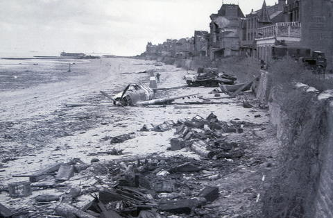 A crashed U.S. fighter plane is seen on the waterfront some time after Canadian forces came ashore on a Juno Beach D-Day landing zone in Saint-Aubin-sur-Mer, France, in June 1944.