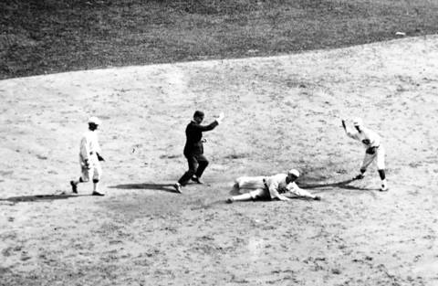 Chick Gandil of the Chicago White Sox is out at second on a throw from Larry Kopf to Morrie Rath during World Series action, in the second inning of game one, on October 1, 1919 in Cincinnati.