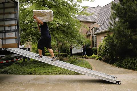 "Movers haul away furniture from the rented home of rapper Keith Cozart, or ""Chief Keef,"" as the rapper vacates the Highland Park house."