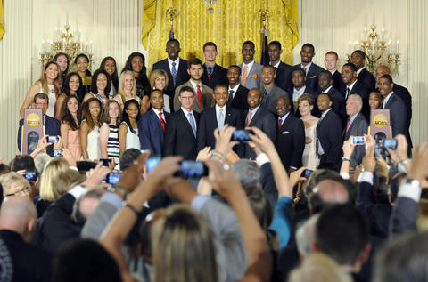 President Barack Obama poses for photos with the UConn men's and women's basketball teams.