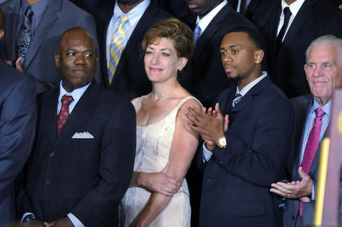 UConn men's assistant coach Karl Hobbs, UConn president Susan Herbst, UConn guard Ryan Boatright, and UConn Board of Trustees president Larry McHugh (l-r) listen as President Barack Obama honors the NCAA Champion UConn men's and women's basketball teams.