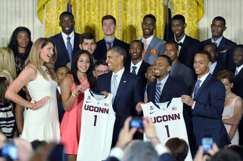 President Barack Obama shares a laugh with Stefanie Dolson (left) after he was presented with UConn jerseys.