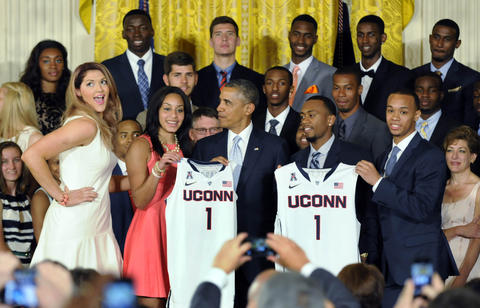 Stefanie Dolson hams it up after giving UConn jerseys to President Barack Obama with Bria Hartley, Ryan Boatright and Shabazz Napier.