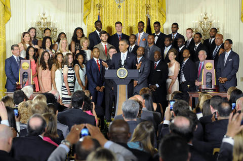 President Barack Obama honors the NCAA Champion UConn men's and women's basketball teams in the East Room at the White House Monday afternoon.