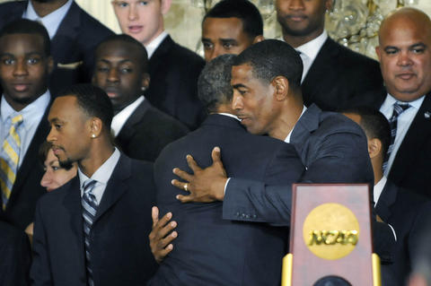 President Barack Obama hugs UConn men's basketball head coach Kevin Ollie at the end of the ceremony.