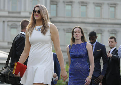 UConn's Stefanie Dolson, Breanna Stewart and DeAndre Daniels (l-r) arrive at a press conference outside the White House.