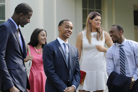 UConn basketball players DeAndre Daniels, Bria Hartley, Shabazz Napier, Stefanie Dolson and Ryan Boatright share a laugh at a press conference outside of the White House.