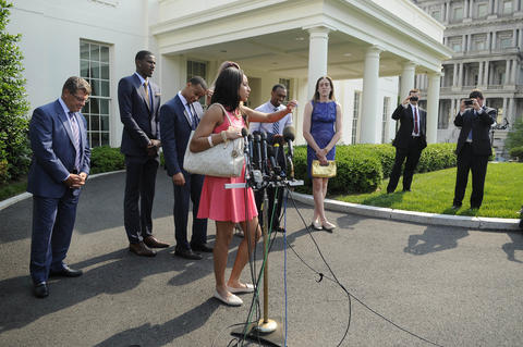 Bria Hartley takes a question at a press conference at the White House.