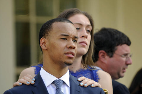 Shabazz Napier and Breanna Stewart hang out at the end of a press conference at the White House Monday.