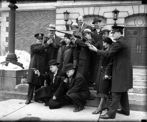 Austin shop keepers have target practice with guns to protect themselves against bandits, circa March 29, 1932. The group posed at the Austin Town Hall.
