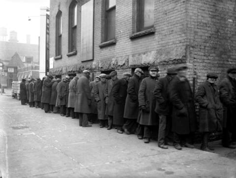 Men wait in a breadline at Peoria Street and Washington Boulevard, just off of Skid Row, to get a meal at a shelter on Dec. 25, 1933.