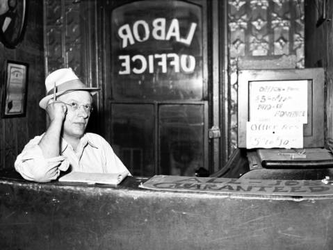 A man works the desk at the Great Northern Employment Bureau at 601 W. Madison Street on July 30, 1937.
