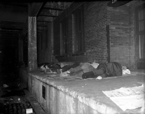The homeless sleep on the lower level of Wacker Drive in Chicago, circa Oct. 5, 1931.