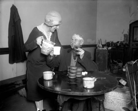 Betty Walker serves Frank Beatz at Hobo College, circa Nov. 18, 1925.