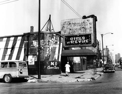 A shuttered strip club bar, one of many folding in the area, is shown at Madison and May Streets in Chicago on Sept. 30, 1964.