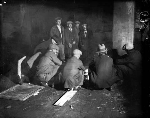 Men gather around a fire on Lower Wacker Drive, circa Oct. 12, 1931.