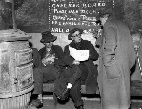 Unemployed or homeless men discuss the situation in Spain as they sit around the stove at Hobo College, 1118 W. Madison Street, on Feb. 6, 1937. Hobo College, founded in 1908, was were men of the road gathered to talk and listen to lectures on everything from philosophy and politics to personal hygiene and vagrancy laws, according to the Encyclopedia of Chicago. For nearly three decades, the college provided education and fostered a spirit of community among the men.