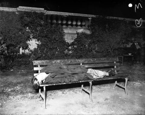 A young man sleeps on a bench in Grant Park, circa Oct. 5, 1931.