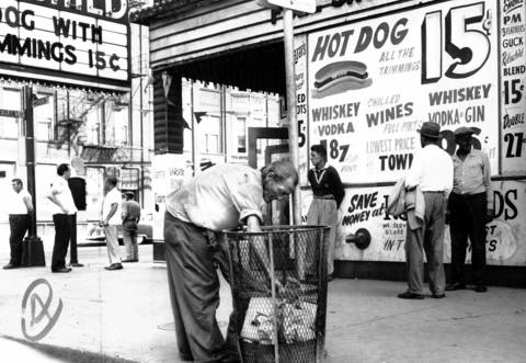 Skid Row, as seen here at Desplaines and Madison Streets, circa Aug. 28, 1960, is blighted buildings, signs offering 15 cent hotdogs and whiskey.