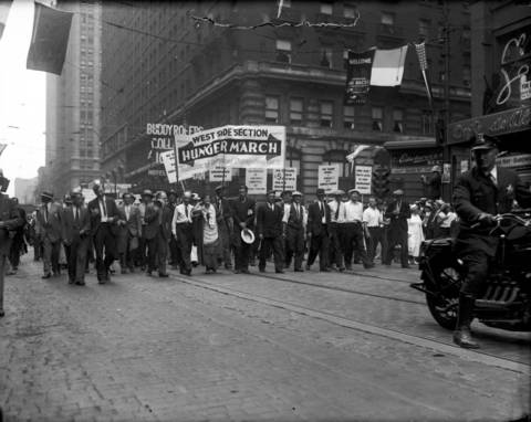The Unemployment Parade, made up of the Federation of Unemployed Organizations of Cook County, passes city hall on Aug. 30, 1933.