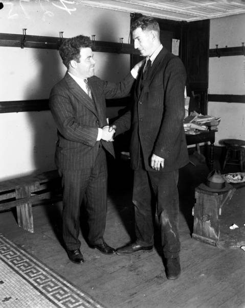 "Jim Tully, called the ""hobo novelist"", left, and Gerald S. Trumbull at Hobo College, circa Nov. 17, 1925. Tully, who had been a professional boxer, tree surgeon, hobo, and writer, wrote many books including his autobiography, ""Beggers of Life."" Tully mostly wrote about the American underclass."