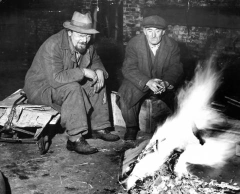 Lawrence Bailis and George Hoppe spend Christmas Day together in 1947, under Wacker Drive and Franklin Boulevard in Chicago.