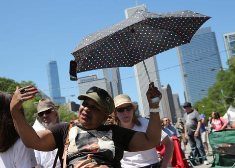 "Patricia Cherry of Chicago enjoys Mr. Sipp ""The Mississippi Blues Child"" at Blues Fest in Grant Park."