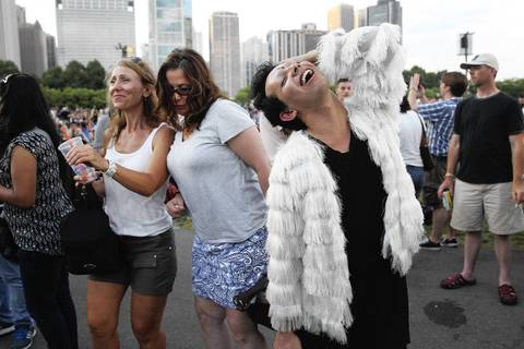 Stella Styrczula, from left, Laura Rezetko, and Will Martinez, dance to the music of the Aaron Neville quartet performing at the Petrillo Music Shell on the final day of the 31st annual Chicago Blues Festival at Grant Park.