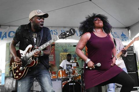 Mr. Sipp, left, jams with Lady A at the Jackson Mississippi Rhythm and Blues Stage during a jam session on the final day of the 31st annual Chicago Blues Festival at Grant Park.