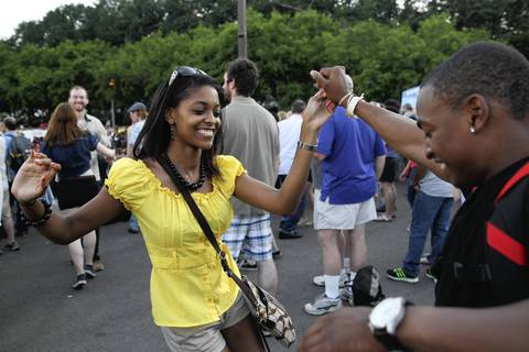 Ebony Ashford, left, dances with her friend Marvin Cosby near the Petrillo Music Shell on the final day of the 31st annual Chicago Blues Festival at Grant Park.