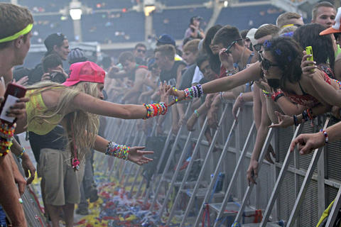 Fans reach out to each other at Spring Awakening, a three-day electronic dance music festival, held at Soldier Field in Chicago.