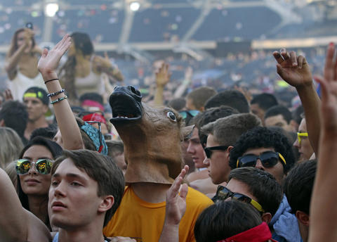 Fans dance at Spring Awakening, a three-day electronic dance music festival, held at Soldier Field in Chicago.