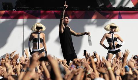 Dancers perform onstage at Spring Awakening, a three-day electronic dance music festival, held at Soldier Field in Chicago.