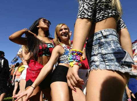 Music fans dance at Spring Awakening, a three-day electronic dance music festival, held at Soldier Field in Chicago.