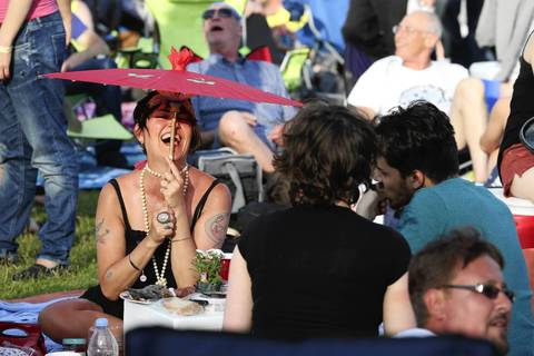 Lily Sauvage, left, of Chicago, laughs with her friends while sitting near the Petrillo Music Shell on the final day of the 31st annual Chicago Blues Festival at Grant Park.