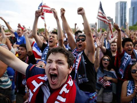 U.S. fans in Grant Park celebrate after an early goal by the U.S. men's team against Ghana.