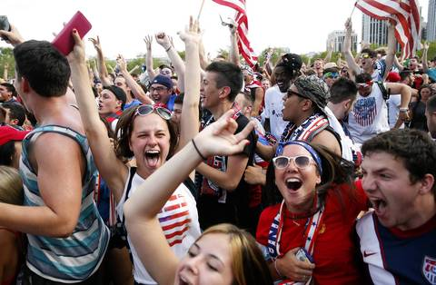 Viktoria Rekafiun of Orland Park, second from left, celebrates an early goal by the U.S. team against Ghana.