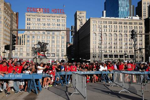 Blackhawk fans wait at Grant Park to enter the rally the team's Stanley Cup win.
