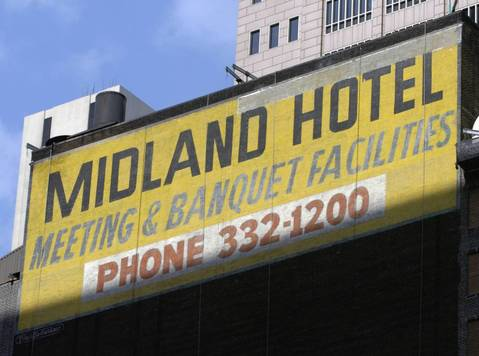 """""""Midland Hotel"""" sign on the west wall of the """"W"""" Hotel at 172 W. Adams Street in 2004. At the time of the photo it was being painted over."""