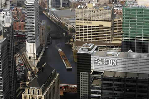Signs for the Chicago Sun-Times, UBS and Boeing, left, on their respective buildings.