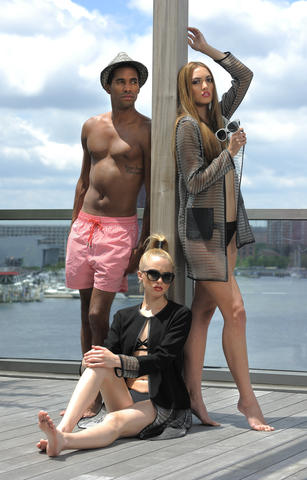 Jahmar (left): Scalise swim trunks, $134, scaliseshop.com. Fedora, $40, Boardwalk-style.com. Felicia (right): Elie Tahari jacket, $565, Mandalynn bikini top, $116, bottom, $96, revolveclothing.com. Earrings, $165, Amaryllis. DKNY sunglasses, $100, Sunglass Hut. Chrissy (center): Elie Tahari jacket, $528, Handbags in the City. Mandalynn bikini top, $98, bottom, $88. Earrings, $165, Amaryllis. DKNY sunglasses, $100, Sunglass Hut.
