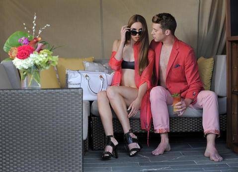 William: Pima trousers, $150, Sand sport coat, $795, both from Gian Marco Menswear. Felicia: Elie Tahari jacket, $298, Diane von Furstenberg purse, $695, both from Handbags in the City. Mandalynn bikini top, $116, bottom, $114. United Nude sandal, $479, unitednude.com. Vogue sunglasses, $100, Sunglass Hut.