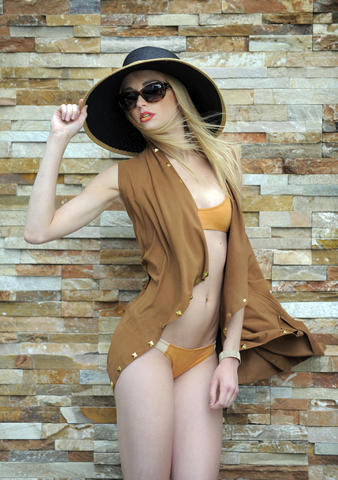 Chrissy: Michael Kors suede vest, $450, Handbags in the City, Mandalynn bikini top, $112, bottom, $98. Boardwalk Style hat, $30, Boardwalk-Style.com