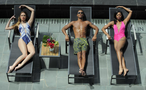 (Left to right) Blair: Kenneth Cole swimsuit, $109.50, South Moon Under.  Jahmar: Swiss Army-Victorinox trunks, $95, Gian Marco Menswear.  Felicia: Nanette Lepore swimsuit, $170, South Moon Under.