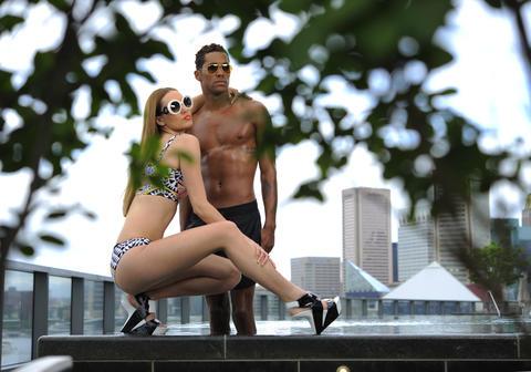 Felicia: bikini top, $132, bottom, $102, marahoffman.com. Prada sunglasses, $675, Handbags in the City. United Nude wedges, $249, unitednude.com. Jahmar: Scalise swim trunks, $107, scaliseshop.com.