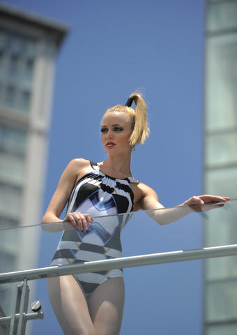 Chrissy: Lenny Niemeyer swimsuit, $290, lennyniemeyer.com/usa. Earrings, $165, Amaryllis