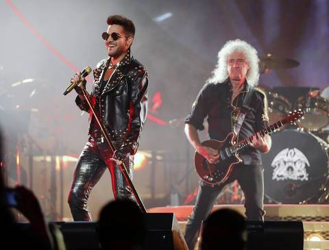 Queen's Brian May, right, and Adam Lambert perform at United Center in Chicago.