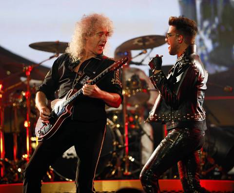 Queen's Brian May, left, and Adam Lambert perform at United Center in Chicago.