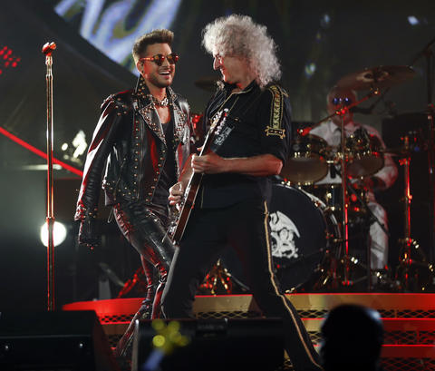 Queen's Brian May and Adam Lambert perform at the United Center.
